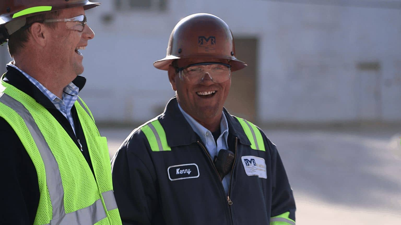 two site employees laughing